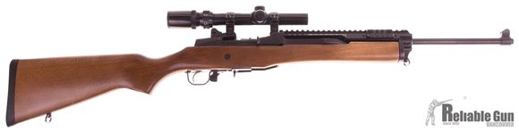 Picture of Used Ruger Mini 14 Ranch Semi Auto Rifle, 223, Wood Stock, Blued Barrel, Amegaranges Scout Mount Rail, Bushnell 1.5-4 Scope, 1 Magazine, Very Good Condition